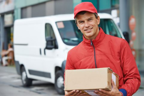 bigstock-Smiling-male-postal-delivery